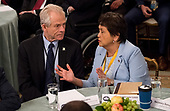 Director of Trade and Industrial Policy, Director of the White House National Trade Council Peter Navarro speaks to Governor Lou Leon (Democrat of Guam) before President Donald Trump speaks to a group of governors during the 2019 White House Business Session at the White House in Washington, D.C. on February 25, 2019. Trump discusses the group on infrastructure, the opioid epidemic, border security and China trade policy. <br /> Credit: Kevin Dietsch / Pool via CNP