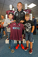 Pictured: Lee Trundle with a young fan. Friday 24 August 2018<br /> Re: Swansea City FC third kit launch at the club shop, Liberty Stadium, Swansea, Wales, UK.
