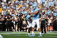 CHAPEL HILL, NC - SEPTEMBER 21: Sam Howell #7 of the University of North Carolina takes the snap during a game between Appalachian State University and University of North Carolina at Kenan Memorial Stadium on September 21, 2019 in Chapel Hill, North Carolina.