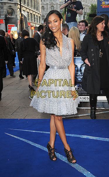 "ZOE SALDANA.UK Film Premiere of ""Star Trek"" held at the Empire Cinema, Leicester Square, London, England. .April 20th 2009 .full length grey gray silver beaded beads patterned pattern dress black shoes sandals heels open toe booties lace-up cuff bracelets .CAP/BEL.©Tom Belcher/Capital Pictures."