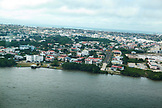 BELIZE. Belize City, aerial view of Belize City and the Caribbean Sea