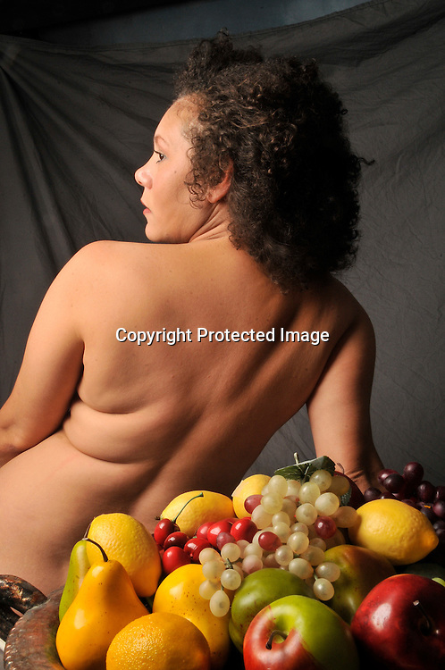 Photograph of a obese woman with fruit