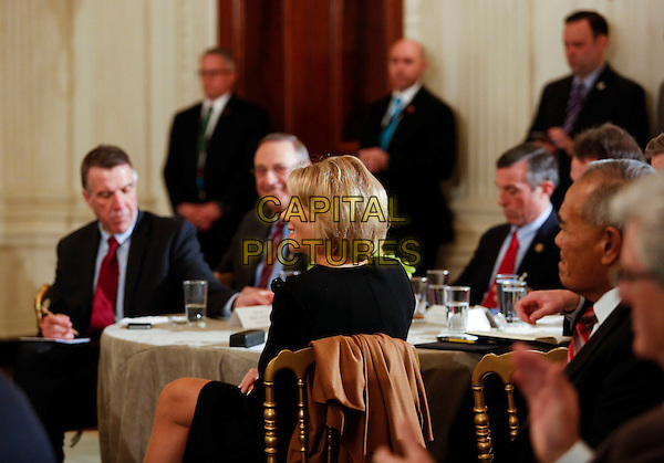 United States Secretary of Education Betsy DeVos listens to U.S. President Donald Trump at the National Governors Association meeting in the State Dining Room of the White House, Washington, DC, February 27, 2017. <br /> CAP/MPI/CNP/RS<br /> &copy;RS/CNP/MPI/Capital Pictures