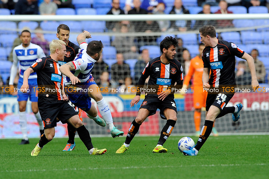 David Perkins of Blackpool follows theough on a tackle on Jamie Mackie of Reading - Reading vs Blackpool - Sky Bet Championship Football at the Madejski Stadium, Reading, Berkshire - 25/10/14 - MANDATORY CREDIT: Denis Murphy/TGSPHOTO - Self billing applies where appropriate - contact@tgsphoto.co.uk - NO UNPAID USE