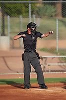 Home plate umpire Bailey Dutten calls a batter out on strikes during an Arizona League game between the AZL Giants Black and the AZL Giants Orange on July 19, 2019 at the Giants Baseball Complex in Scottsdale, Arizona. The AZL Giants Black defeated the AZL Giants Orange 8-5. (Zachary Lucy/Four Seam Images)