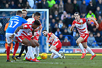 John Marquis of Doncaster Rovers right looks for the ball during Portsmouth vs Doncaster Rovers, Sky Bet EFL League 1 Football at Fratton Park on 2nd February 2019
