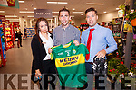 Marc Ó Sé Kerry footballer, pictured picking the winner from the charity raffle for his jersey and football boots, which was in aid of the Recovery Haven, Tralee, at Garvey's Supervalu, Tralee, 25th anniversary celebrations on Saturday last were l-r: Helen Griffen (trainee manager), Marc Ó Sé and Chris O'Driscoll (store manger).