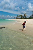 Small kid playing on the beach of Koh Lipe island, Thailand