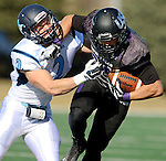 SIOUX FALLS, SD - NOVEMBER 8: Garrett Shutt #24 from the University of Sioux Falls tries to shake the grasp of Jeff Arends #2 from Upper Iowa in the first quarter of their game Saturday afternoon at Bob Young Field in Sioux Falls.  (Photo by Dave Eggen/Inertia)
