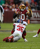 New York Giants free safety Curtis Riley (35) tackles against the Washington RedskinsWashington Redskins wide receiver Jamison Crowder (80) in second quarter action Landover, Maryland on Sunday, December 9, 2018.<br /> Credit: Ron Sachs / CNP<br /> (RESTRICTION: NO New York or New Jersey Newspapers or newspapers within a 75 mile radius of New York City)