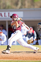 Cole Rakar #12 of the College of Charleston Cougars follows through on his swing against the Davidson Wildcats at Wilson Field on March 12, 2011 in Davidson, North Carolina.  The Wildcats defeated the Cougars 8-3.  Photo by Brian Westerholt / Four Seam Images