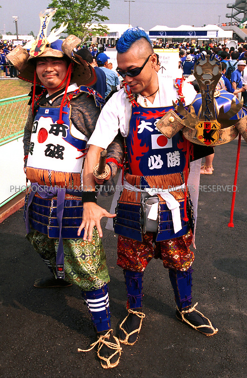 6/4/2002--Saitama, Japan..Japanese fans outside Saitama stadium dresses as ancient samurai before the Japan Belgium Group H match. Jap;an drew 2-2 with Belgium...All photographs ©2003 Stuart Isett.All rights reserved.This image may not be reproduced without expressed written permission from Stuart Isett.