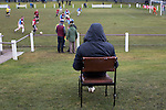 A spectator sitting in a chair watching the action at Ferguson Park, Rosewell, as Whitehill Welfare take on Gala Fairydean Rovers in a Scottish Lowland League fixture, which the home team won 3-0. The match was one of six arranged by the league and GroundhopUK over the weekend to accommodate groundhoppers, fans who attempt to visit as many football venues as possible. Around 100 fans in two coaches from England participated in the 2016 Lowland League Groundhop and they were joined by other individuals from across the UK which helped boost crowds at the six featured matches.