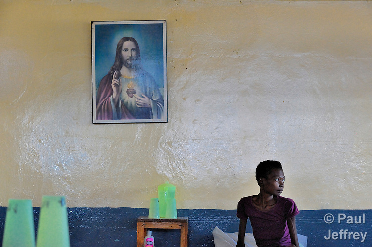 "A patient at the ""House for the Dying"", a hospice for AIDS patients and other terminally ill patients run by the Sisters of Charity in Port au Prince, Haiti."
