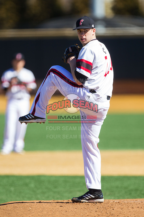 Cincinnati Bearcats starting pitcher Mitch Patishall (24) in action against the Radford Highlanders at Wake Forest Baseball Park on February 22, 2014 in Winston-Salem, North Carolina.  The Highlanders defeated the Bearcats 6-5.  (Brian Westerholt/Four Seam Images)