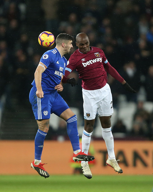 West Ham United's Angelo Ogbonna and Cardiff City's Callum Paterson<br /> <br /> Photographer Rob Newell/CameraSport<br /> <br /> The Premier League - West Ham United v Cardiff City - Tuesday 4th December 2018 - London Stadium - London<br /> <br /> World Copyright © 2018 CameraSport. All rights reserved. 43 Linden Ave. Countesthorpe. Leicester. England. LE8 5PG - Tel: +44 (0) 116 277 4147 - admin@camerasport.com - www.camerasport.com