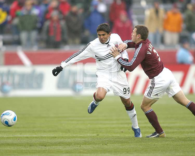 Greg Vanney crashes into Jaime Moreno #99. In their first game in their new stadium Colorado Rapids held on to beat DC United 2-1 at Dick's Sporting Goods Park in Commerce City, Colorado on April 7 2007 before the first sellout crowd in Rapids history.