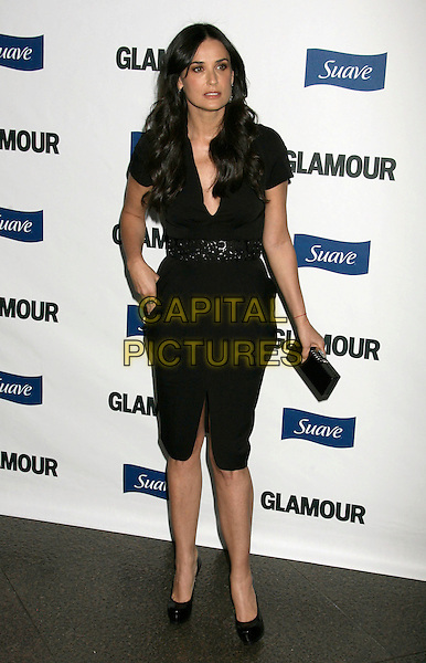 DEMI MOORE.2008 Glamour Reel Moments held at the Directors Guild of America, Los Angeles, California, USA..October 14th, 2008.full length black dress belt clutch bag.CAP/ADM/MJ.©Michael Jade/AdMedia/Capital Pictures.