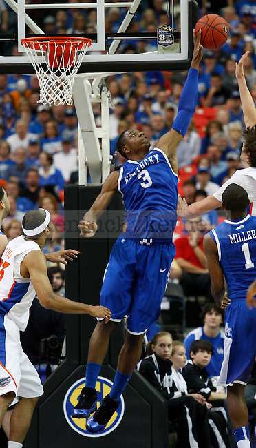 Terrence Jones goes up to block a shot by Chandler Parsons during the championship of the 2011 SEC Men's Basketball Tournament between Kentucky and Florida, played at the Georgia Dome, Sunday, March 13, 2011.  Photo by Latara Appleby | Staff