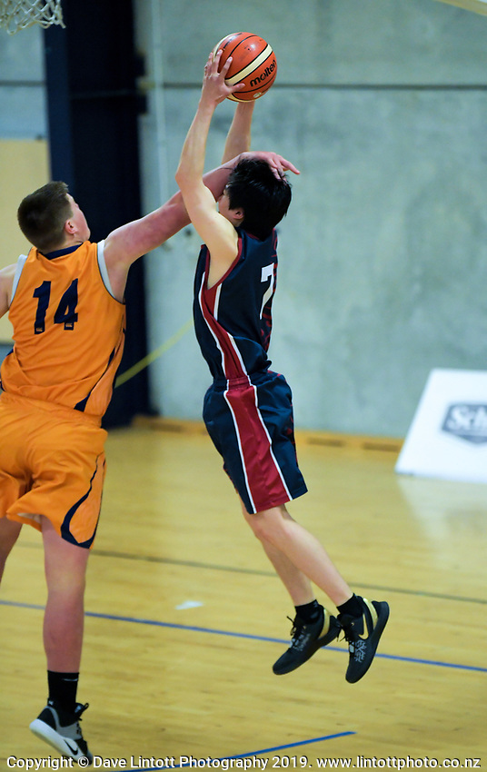 Action from the 2019 Schick A Boys' Secondary Schools Basketball Premiership National Championship match between Opunake High School and Kavanagh College at the Central Energy Trust Arena in Palmerston North, New Zealand on Monday, 30 September 2019. Photo: Dave Lintott / lintottphoto.co.nz