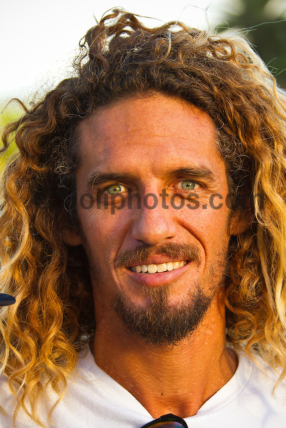 Haleiwa Hawaii,(Saturday November 13, 2010) Rob Machado (USA) at The 2010 World Miss Reef Hawaiian Pro, presented by Seven Tiki Rum, kicked off November 13th at Ali'i Beach Park at 4pm. Miss Reef hopefuls arrived from countries like Panama, the Netherlands, Indonesia, Chile and the U.S. to compete for the World Miss Reef Title. The winner, Betzy from Panama will appear in the renowned Miss Reef Calendar and receives $10,000 worth of cash prizes. Surfers Connor Coffin (USA) Rob Machado (USA) and Dean Morrison (AUS) were members of the judging panel..Photo: joliphotos.com