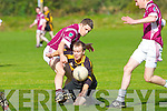 Dromid Pearses Cian Hallissey and Clounmacon's Jack Toomey fight for the ball in the Barrett Cup Final at Farranfore on Saturday.