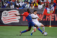 Jay Heaps (16) of the United States (USA) battles a Haitian player. The United States and Haiti played to a 2-2 tie during a CONCACAF Gold Cup Group B group stage match at Gillette Stadium in Foxborough, MA, on July 11, 2009. .