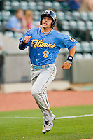 Jake Skole (9) of the Myrtle Beach Pelicans hustles down the third base line on his way to scoring a run against the Winston-Salem Dash at BB&T Ballpark on May 15, 2013 in Winston-Salem, North Carolina.  The Pelicans defeated the Dash 9-2.  (Brian Westerholt/Four Seam Images)