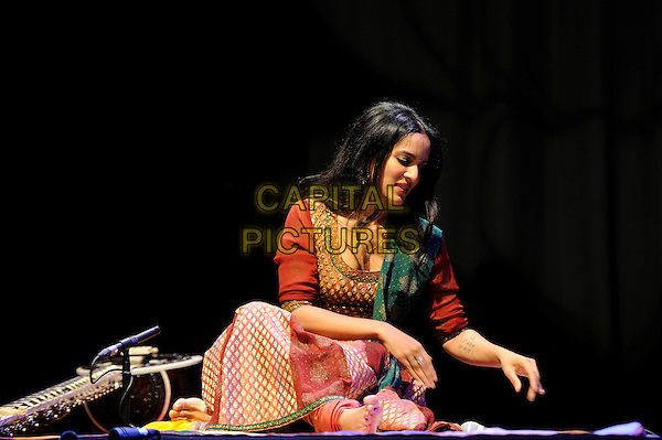 Anoushka Shankar.performing in concert, Queen Elizabeth Hall, Waterloo, London, England, UK, 13th April 2013..music live on stage performing gig half length sitting indian dress sari costume orange red gold embroidered patterned green silk  playing traditional Indian classical bare foot feet .CAP/MAR.© Martin Harris/Capital Pictures.