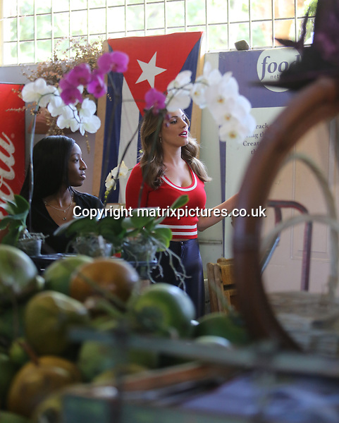 """NON EXCLUSIVE PICTURE: MATRIXPICTURES.CO.UK.PLEASE CREDIT ALL USES..UK, AUSTRALIA, NEW ZEALAND AND ASIA RIGHTS ONLY..English model and media personality Kelly Brook is pictured wearing dark blue high-wasted """"disco pants"""" whilst shooting on location for a new commercial in Little Havana, Miami today...The newly single beauty appears to have thrown herself into her work following her recent split from boyfriend Scottish rugby player Thom Evans...FEBRUARY 3rd 2013..REF: KDA 13719..XIM"""