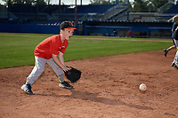 Batavia Muckdogs youth baseball clinic participant fields a ground ball on August 30, 2017 at Dwyer Stadium in Batavia, New York.  (Mike Janes/Four Seam Images)