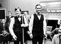 Snooker player ALEX HIGGINS pictured with fellow pro John Spencer at a Park Drive 2000 competition held in Working Mens Clubs in the early 70's
