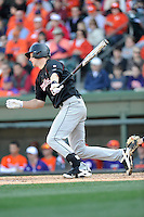 Catcher Grayson Greiner (21) of the South Carolina Gamecocks hits in the Reedy River Rivalry game against the Clemson Tigers on March 1, 2014, at Fluor Field at the West End in Greenville, South Carolina. South Carolina won, 10-2.  (Tom Priddy/Four Seam Images)