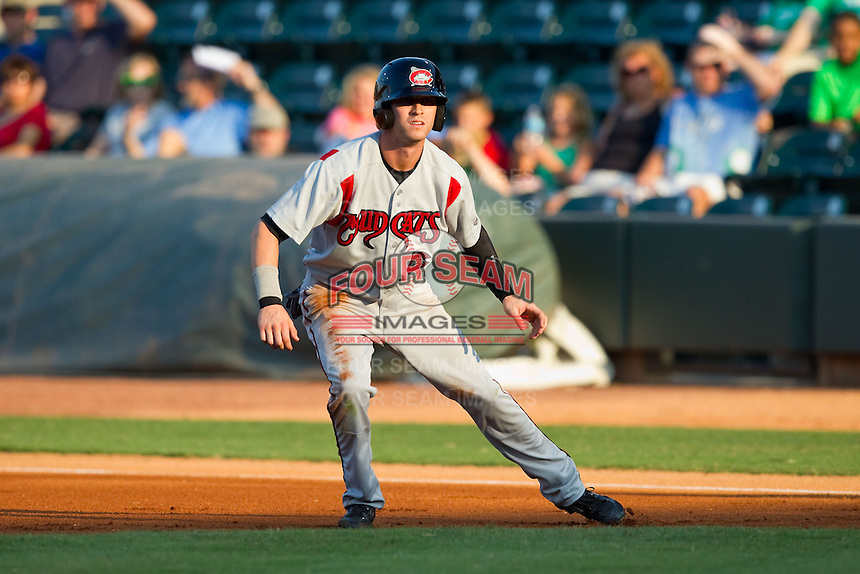 Tyler Naquin (6) of the Carolina Mudcats takes his lead off of first base against the Winston-Salem Dash at BB&T Ballpark on July 25, 2013 in Winston-Salem, North Carolina.  The Mudcats defeated the Dash 5-4.  (Brian Westerholt/Four Seam Images)