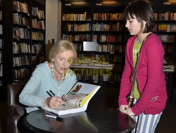 "Mary Berry.signed copies of her new cookbook ""At Home"", Waterstones bookshop, Kensington High St., London, England, UK, .20th April 2013..half length books blue cardigan pearl necklace beads sitting signing book for fan .CAP/CAN.©Can Nguyen/Capital Pictures."