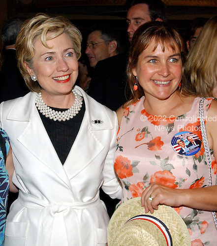 Boston, MA - July  25, 2004 -- United States Senator Hillary Rodham Clinton (Democrat of New York) with an unidentified woman wearing the New York Delegation button at the New York Delegation reception in Boston, Massachusetts on July 25, 2004.  The button shows Senators Kerry and Schumer, but not Clinton..Credit: Ron Sachs / CNP