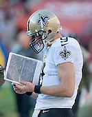 New Orleans Saints quarterback Drew Brees (9) studies the coaching photos from the upper press box during the fourth quarter of the game against the Washington Redskins at FedEx Field in Landover, Maryland on Sunday, November 15, 2015.  The Redskins won the game 47 - 14.<br /> Credit: Ron Sachs / CNP