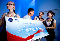 Guide Kirsi (left), Nokia Regional General Manager Tsao Gary (2nd from left), and Pavilion Director Annikka Alanko (2nd from right) congratulate Finland's Pavilion's 4 millionth visitor Liu Xin (right), in Finnish Pavilion 'Kirnu' on Shanghai World Expo 2010 site, in Shanghai, China, on September 19, 2010. Photo by Lucas Schifres/Pictobank
