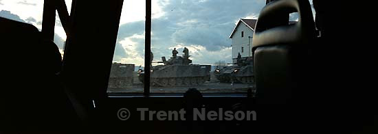 KFOR soldiers and tanks out window<br />
