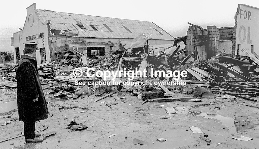 Rep of Ireland policeman at scene of explosion at McLaughlin&rsquo;s Garage, Bridge End, Co Donegal, Rep of Ireland, 20th November 1972, which was claimed by the UDA, Ulster Defence Association, in N Ireland. The garage is located only a few hundred metres from the land border with N Ireland. There were no casualties. 197211200749<br />