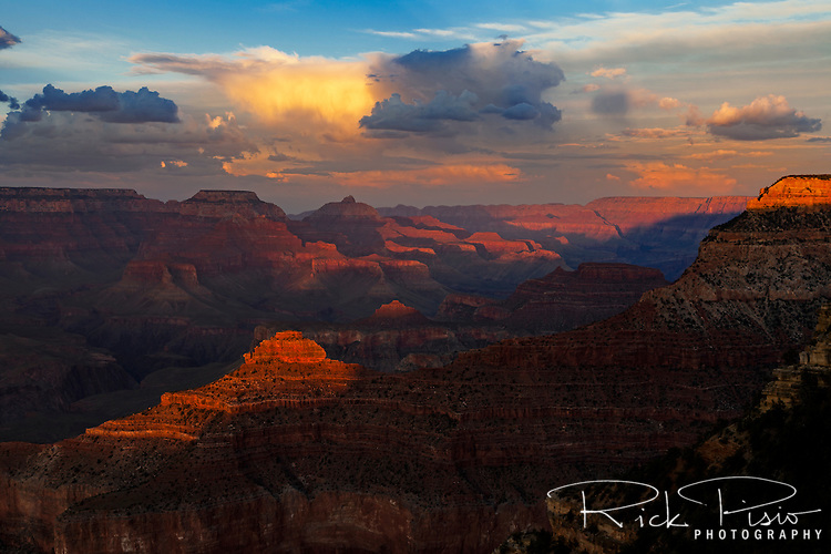 The setting sun casts shadows across the Grand Canyon.