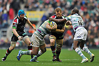 Chris Robshaw is tackled in possession. Big Game 5 Aviva Premiership match, between Harlequins and London Irish on December 29, 2012 at Twickenham Stadium in London, England. Photo by: Patrick Khachfe / Onside Images