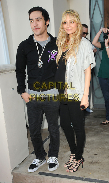 PETE WENTZ (FALL OUT BOY) & NICOLE RICHIE .House of Harlow 1960 & Clandenstine Industries Switch Boutique Runway Show held at Boulevard 3, Hollywood, California, USA..June 4th, 2009.full length black leggings top jacket silver grey gray pregnant strappy sandals .CAP/DVS.©Debbie VanStory/Capital Pictures.