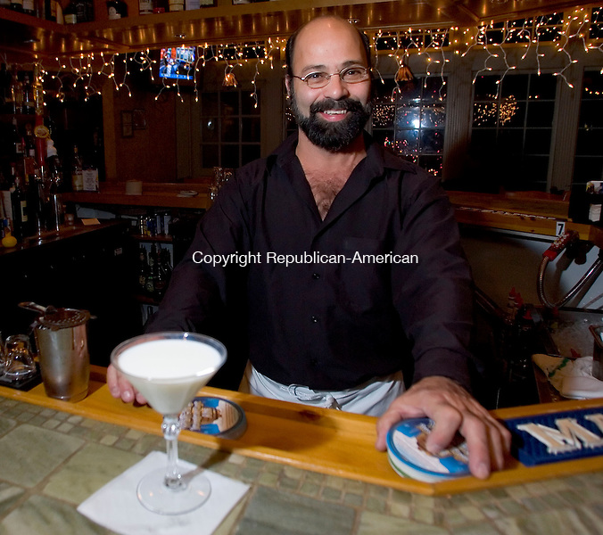 WOODBURY, CT- 07 DEC 06- 120706JT03- <br /> Ren&eacute; Arroyo's specialty at Carlito's of Woodbury is the white chocolate martini.<br /> Josalee Thrift Republican-American