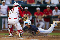North Carolina catcher Brian Holberton (10) slides across the plate as North Carolina State catcher Brett Austin (11) attempts to tag him during Game 10 of the 2013 Men's College World Series against the North Carolina State Wolfpack on June 20, 2013 at TD Ameritrade Park in Omaha, Nebraska. The Tar Heels defeated the Wolfpack 7-0, eliminating North Carolina State from the tournament. (Andrew Woolley/Four Seam Images)