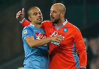 Gokhan Inler   Pepe Reina celebrate at the  end  the Italian Serie A soccer match between SSC Napoli and Juventus FC   at San Paolo stadium in Naples, March 30 , 2014