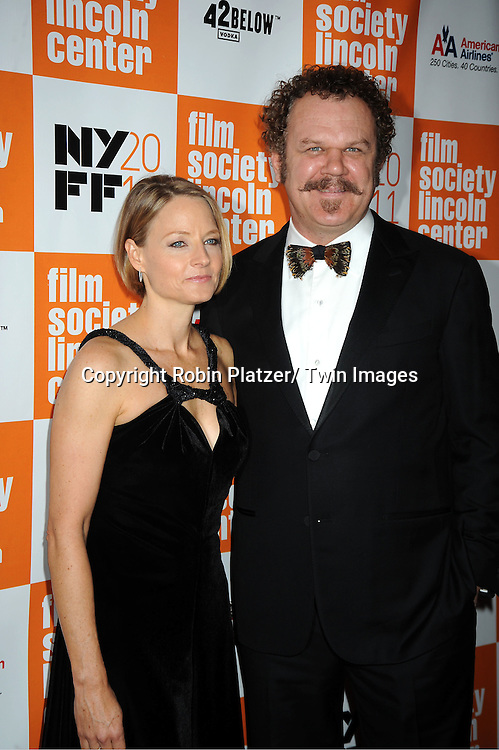 "actress Jodie Foster and John C Reilly attends the 49th Annual New York Film Festival Opening Night Gala presentation of ""Carnage"" on September 30, 2011 at Alice Tully Hall in New York City."