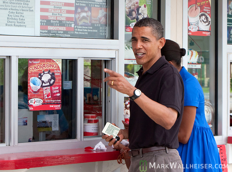 PANAMA CITY BEACH, FL -  AUGUST 15:  President Barack Obama talks to the media when when he, First Lady Michelle and 9 year-old daughter Sasha stopped at Bruster's Real Ice Cream August 15, 2010 in Panama City Beach, Florida.  The Obamas are vacationing in the Florida panhandle.