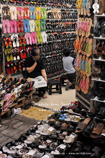Shop owner reading in shoes store (Licence this image exclusively with Getty: http://www.gettyimages.com/detail/83154165 )