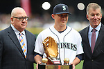Seattle Mariners' Jack Zduriencik, Executive Vice President & General Manager, left, Kyle Seager, and Kevin Mather, President & Chief Operating Officer pose for photos after Seager was presented with a Golden Glove Award before their season home opener against the Los Angeles Angels April 6, 2015 at Safeco Field in Seattle.  The Mariners beat the Angels 4-1.    ©2015. Jim Bryant Photo. ALL RIGHTS RESERVED.